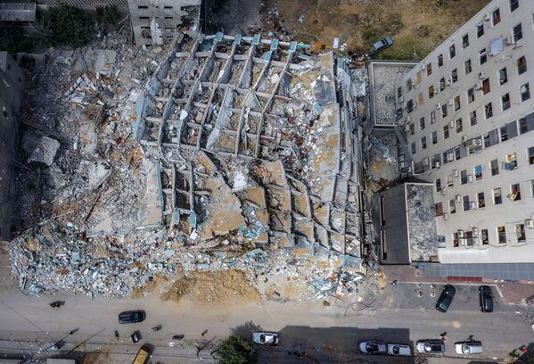 La escalada bélica duró 11 días. En la foto: los escombros de la torre Al Jalaa, en Gaza, destruida por un ataque aéreo israelí. - Sputnik Mundo