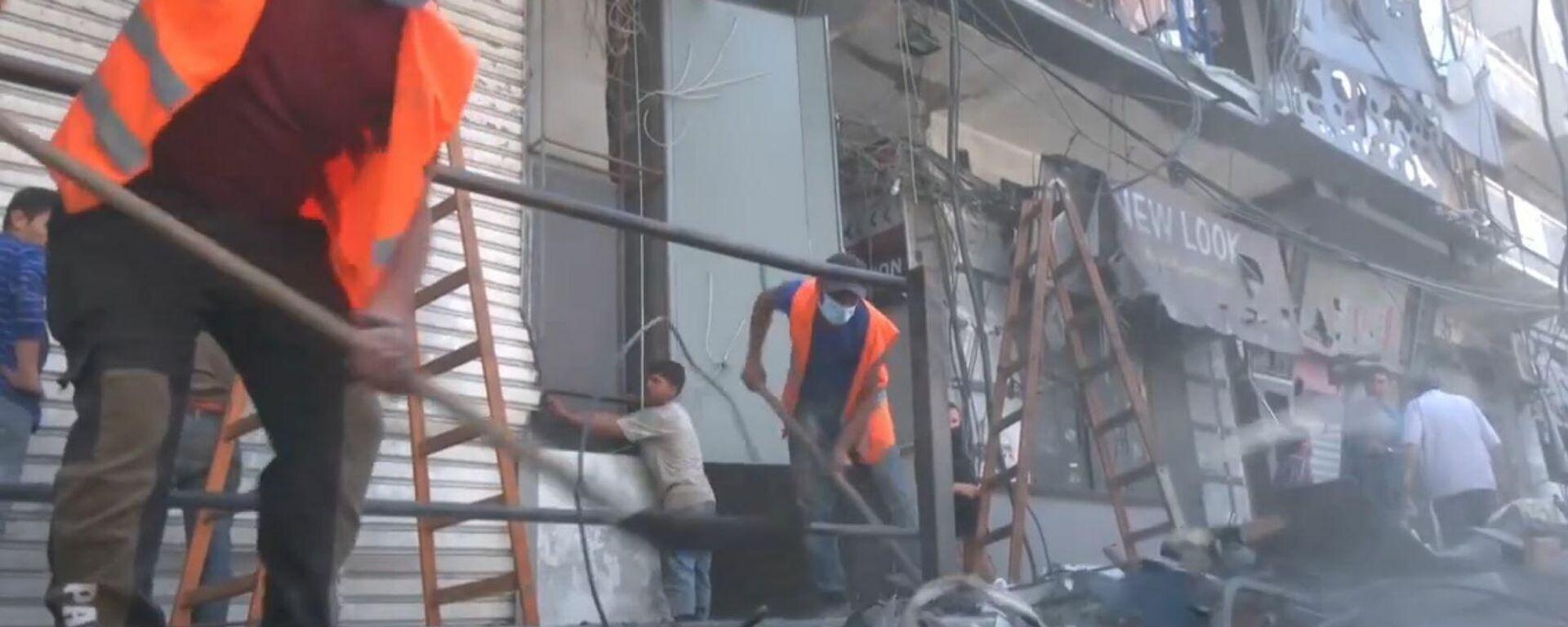 Los habitantes de Gaza reconstruyen la ciudad tras los ataques aéreos israelíes  - Sputnik Mundo, 1920, 23.05.2021