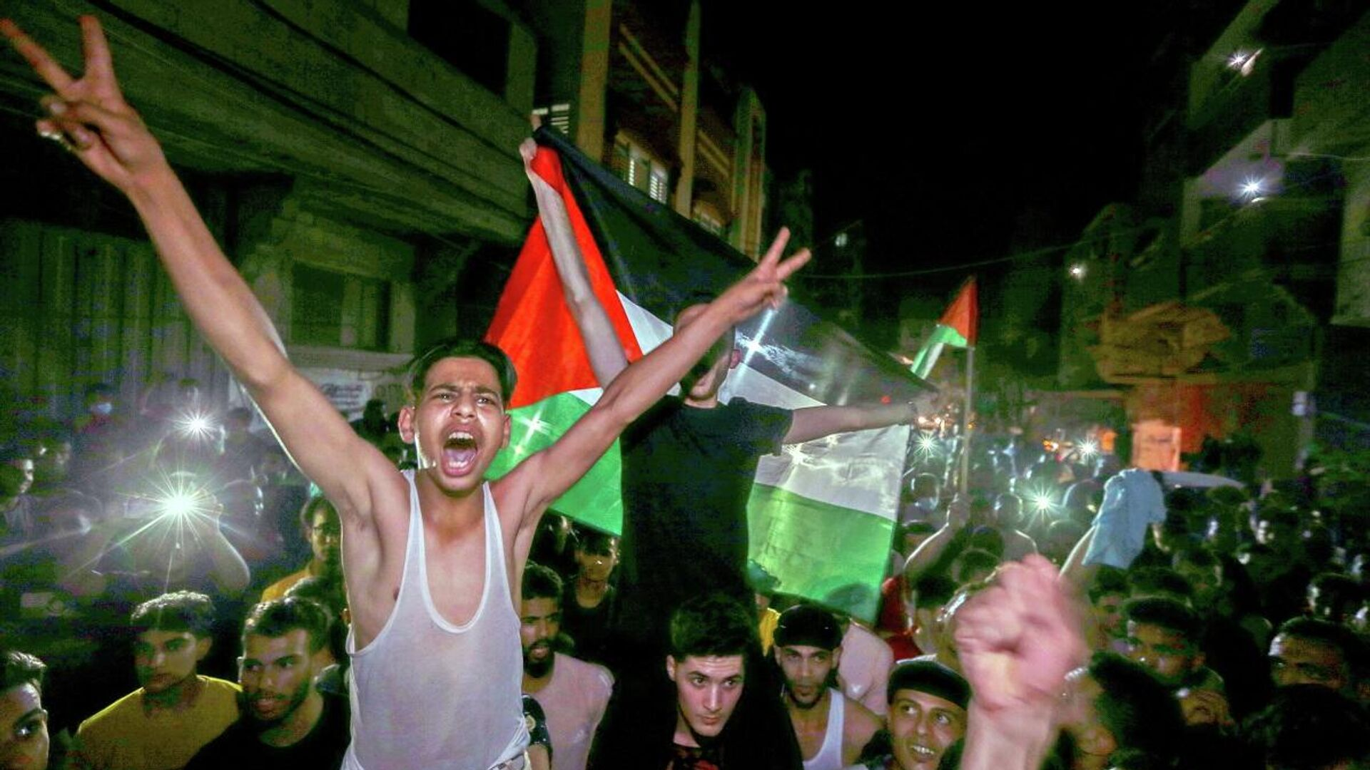 Сientos de palestinos salieron a las calles para celebrar el alto el fuego, el 21 de mayo  - Sputnik Mundo, 1920, 24.05.2021