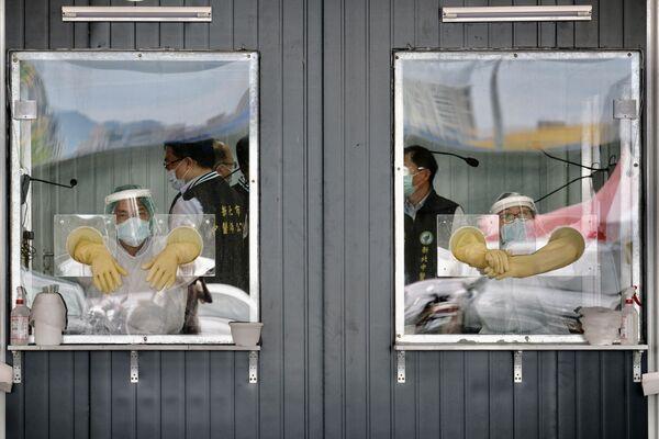 Punto de pruebas de COVID-19 en la ciudad de Nuevo Taipéi, China. - Sputnik Mundo