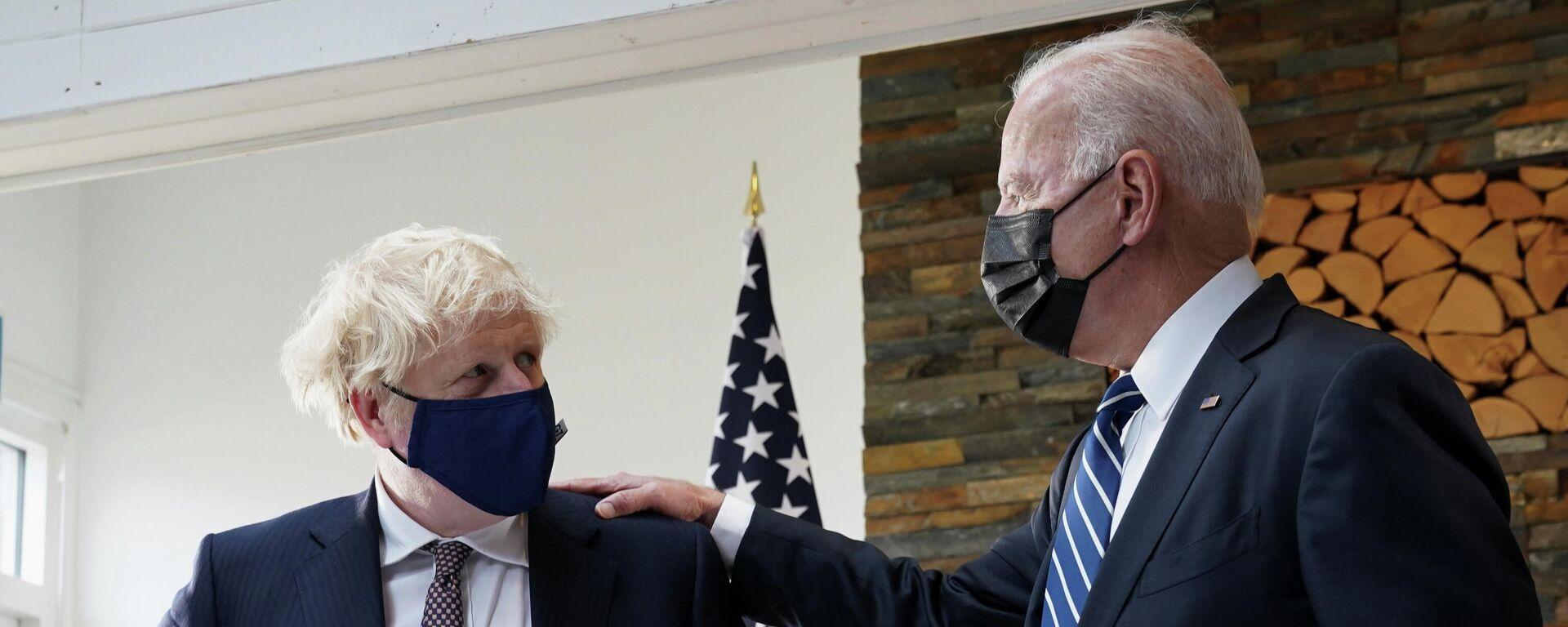 Primer ministro del Reino Unido, Boris Johnson, y presidente de EEUU, Joe Biden - Sputnik Mundo, 1920, 12.06.2021