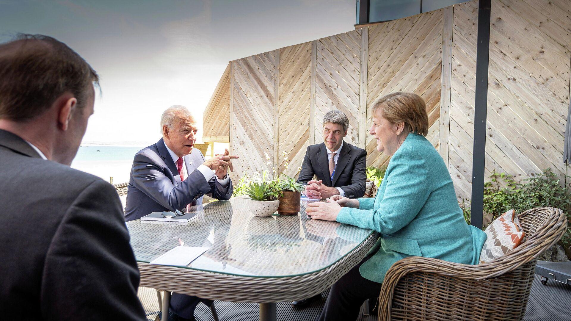 El presidente de EEUU, Joe Biden, y la canciller de Alemania, Angela Merkel - Sputnik Mundo, 1920, 12.06.2021