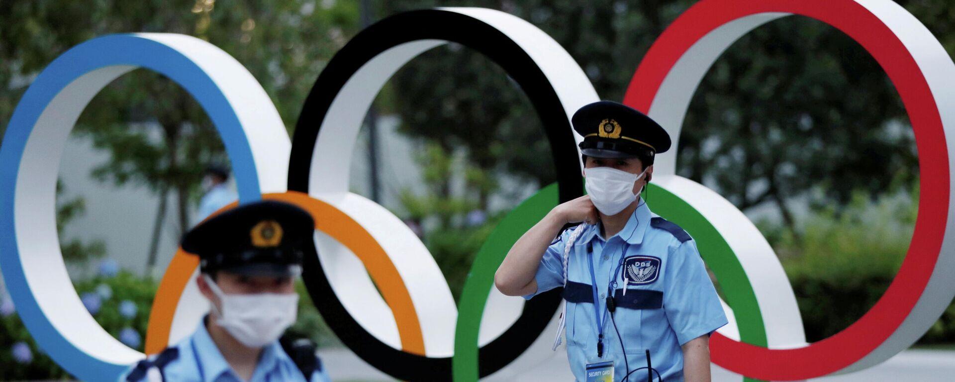 Policías japoneses y anillos olímpicos - Sputnik Mundo, 1920, 15.06.2021