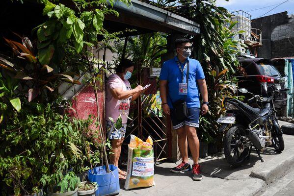 En Filipinas organizan loterías en las cuales se puede ganar incluso un saco de arroz. - Sputnik Mundo