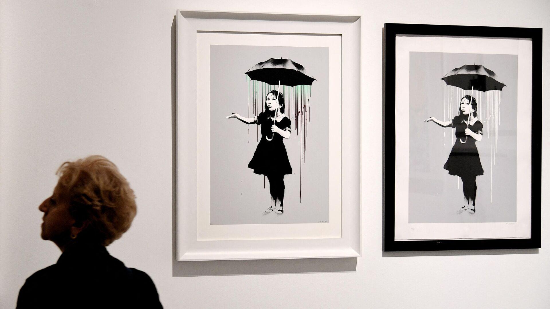 La obra de Banksy 'Chica con paraguas'  - Sputnik Mundo, 1920, 23.06.2021