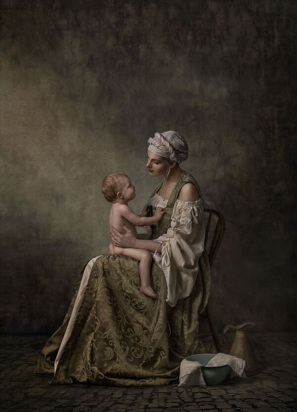 'A quiet connection' ('Una silenciosa conexión'), de la fotógrafa Nancy Flamea, obtuvo el tercer puesto en la categoría Family Sitting. - Sputnik Mundo