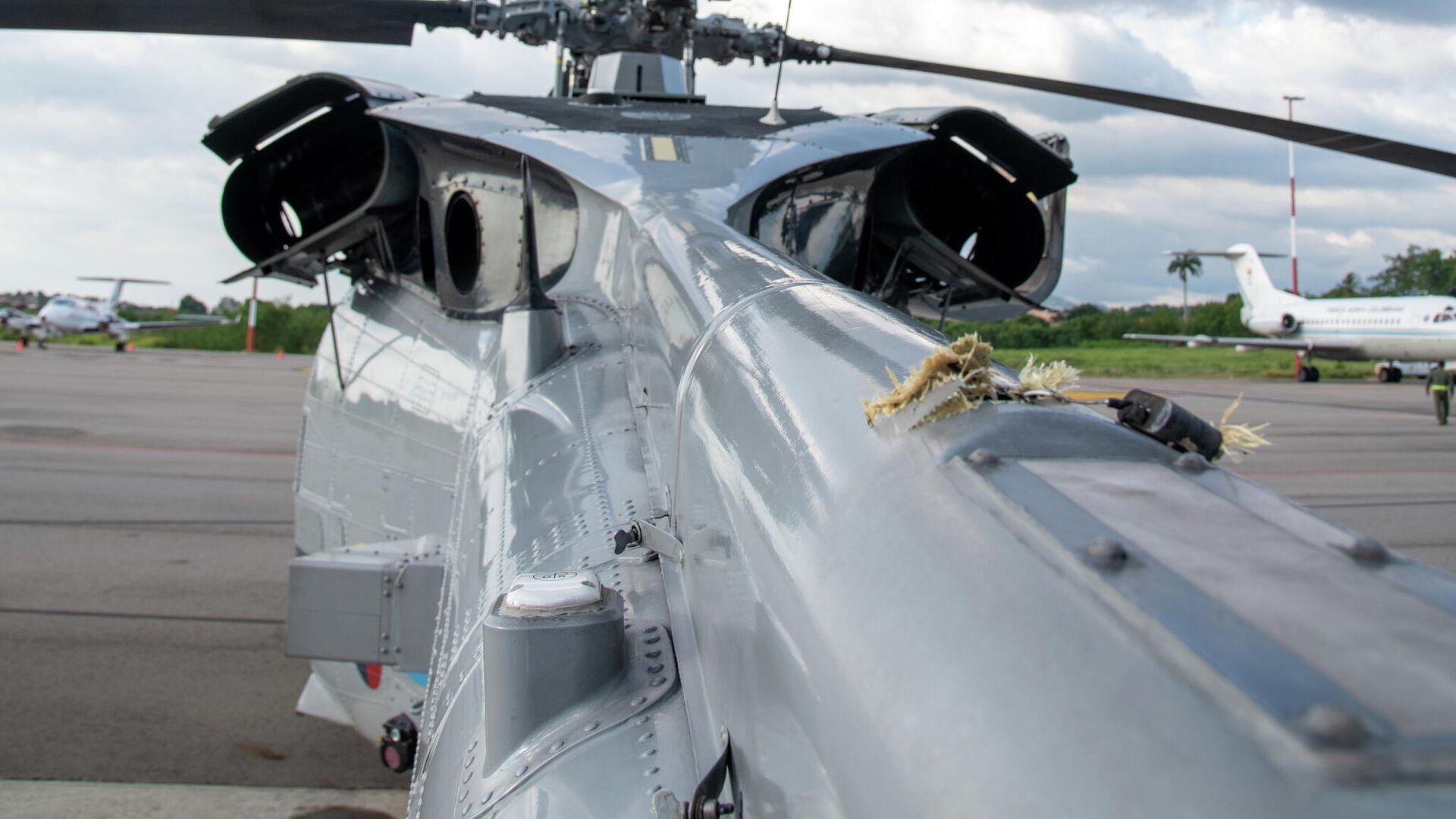 El helicóptero del presidente de Colombia, Iván Duque, tras el ataque - Sputnik Mundo, 1920, 26.06.2021