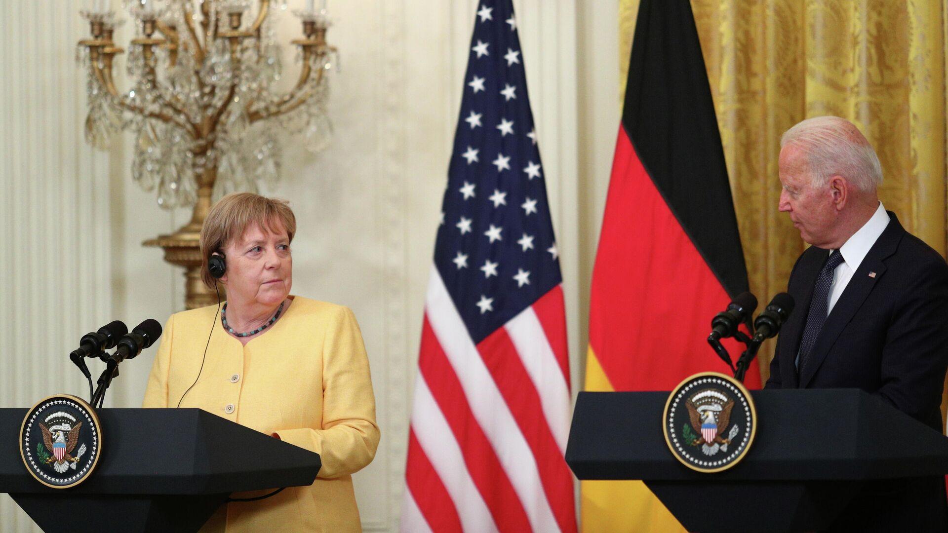 La canciller alemana, Ángela Merkel y el presidente de EEUU, Joe Biden - Sputnik Mundo, 1920, 16.07.2021