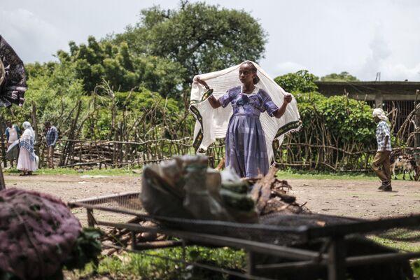 Una mujer en un mercado de la ciudad etíope de Dansha. - Sputnik Mundo