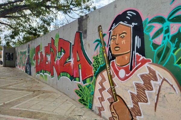 Murales en la Universidad Industrial de Santander (UIS) en Bucaramanga, Colombia, que aluden a la Guardia Indígena. La Guardia Indígena es el cuerpo de protección pacífico de comunidades nativas, usualmente del suroccidente del país. - Sputnik Mundo