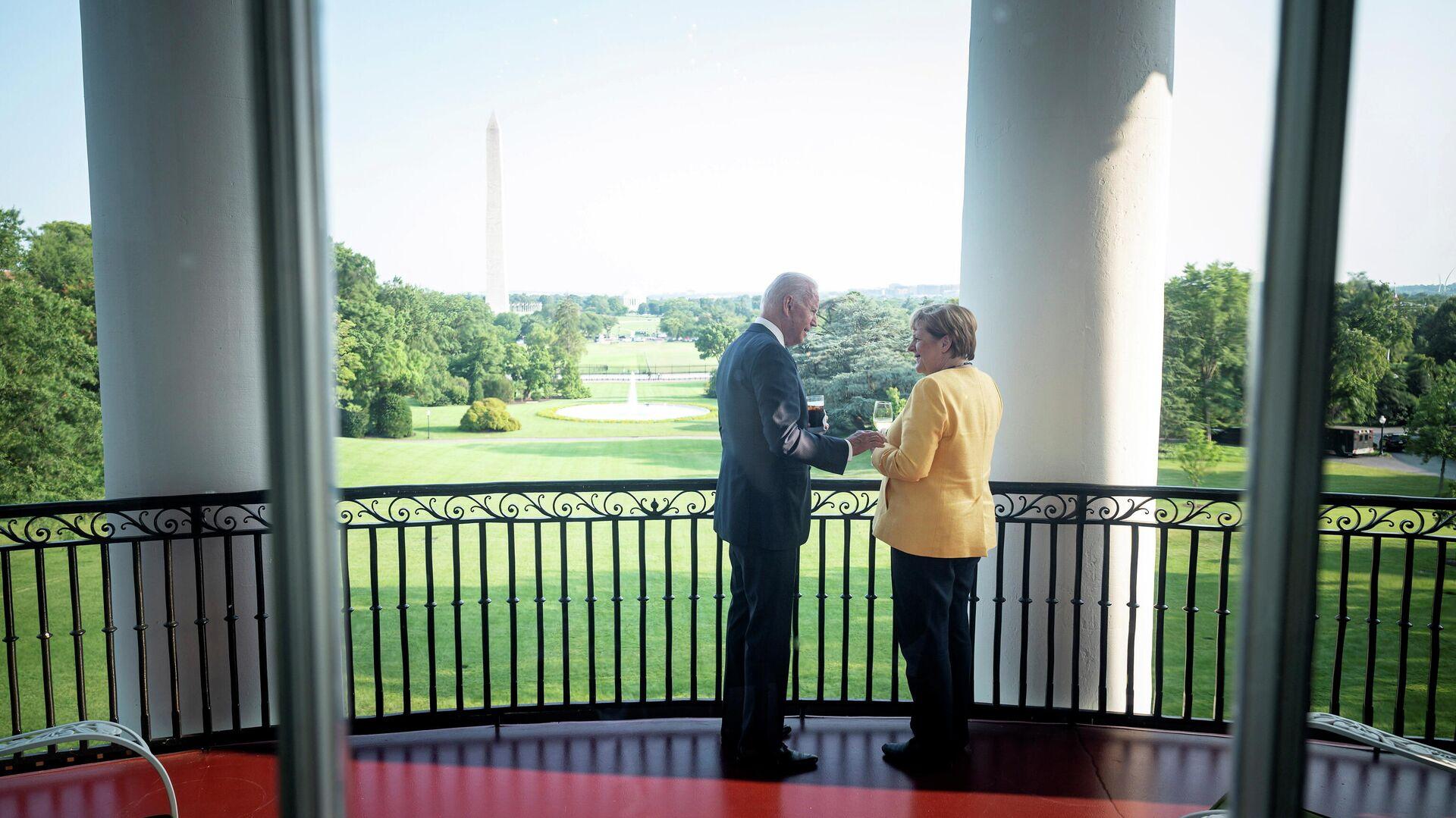 En encuentro del presidente de EEUU, Joe Biden, con la canciller alemana, Angela Merkel - Sputnik Mundo, 1920, 19.07.2021