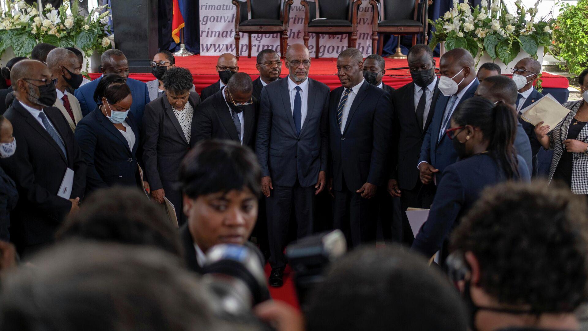 El primer ministro de Haití, Ariel Henry (centro) - Sputnik Mundo, 1920, 21.07.2021