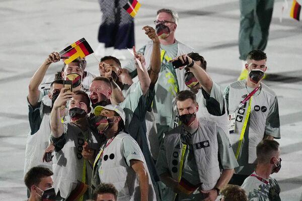 Los atletas de Alemania desfilan durante la ceremonia de apertura. - Sputnik Mundo