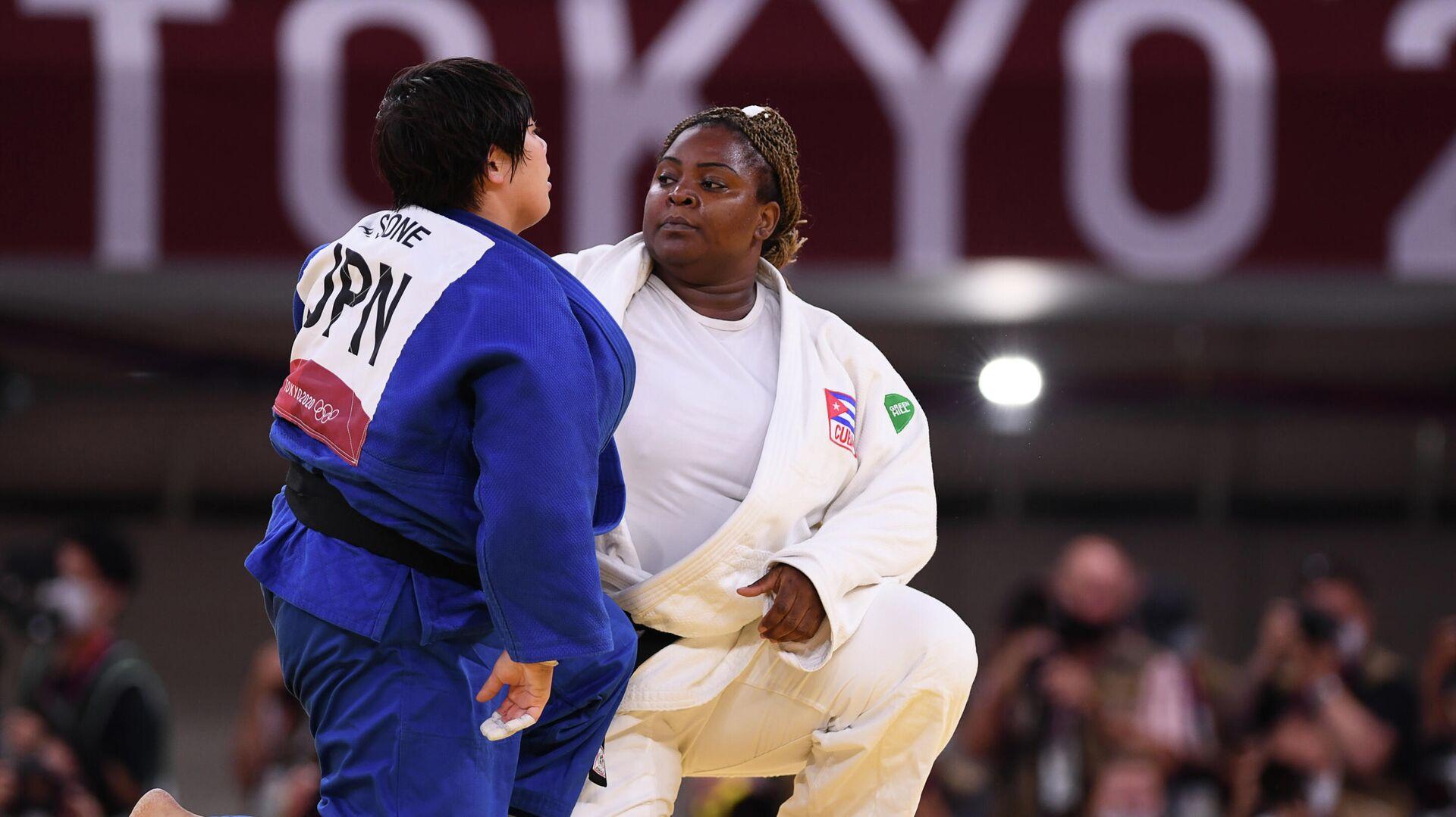 La judoca japonesa Akira Sone y la judoca cubana Idalys Ortiz en los XXXII Juegos Olímpicos en Tokio - Sputnik Mundo, 1920, 30.07.2021