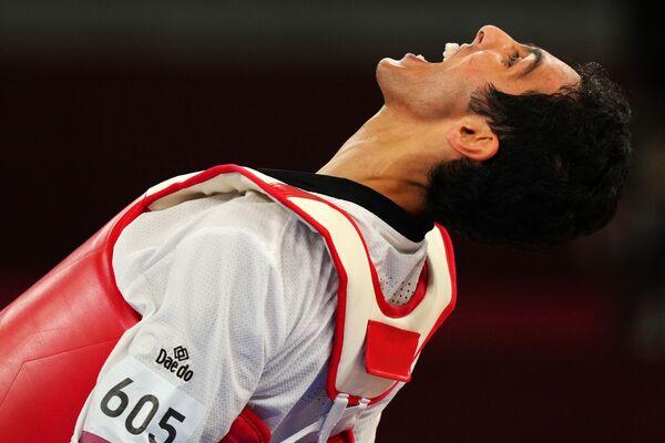 Seif Eissa, de Egipto, ganador de la medalla de bronce en la competencia masculina de taekwondo de menos de 80 kg celebra su hazaña. - Sputnik Mundo