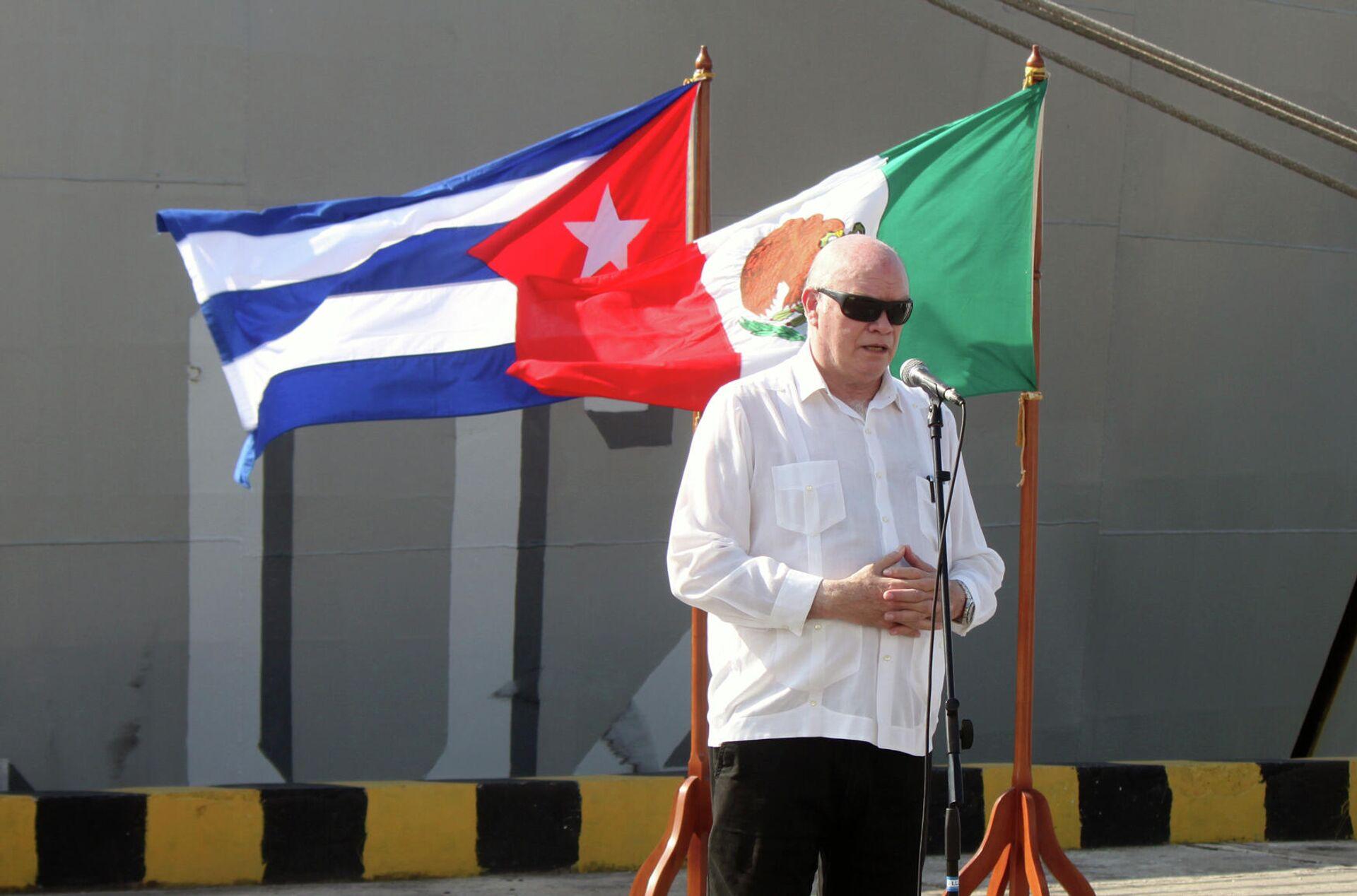 El ministro cubano de Comercio Exterior, Rodrigo Malmierca, durante el recibimiento del buque Libertador, con ayuda humanitaria para Cuba - Sputnik Mundo, 1920, 31.07.2021