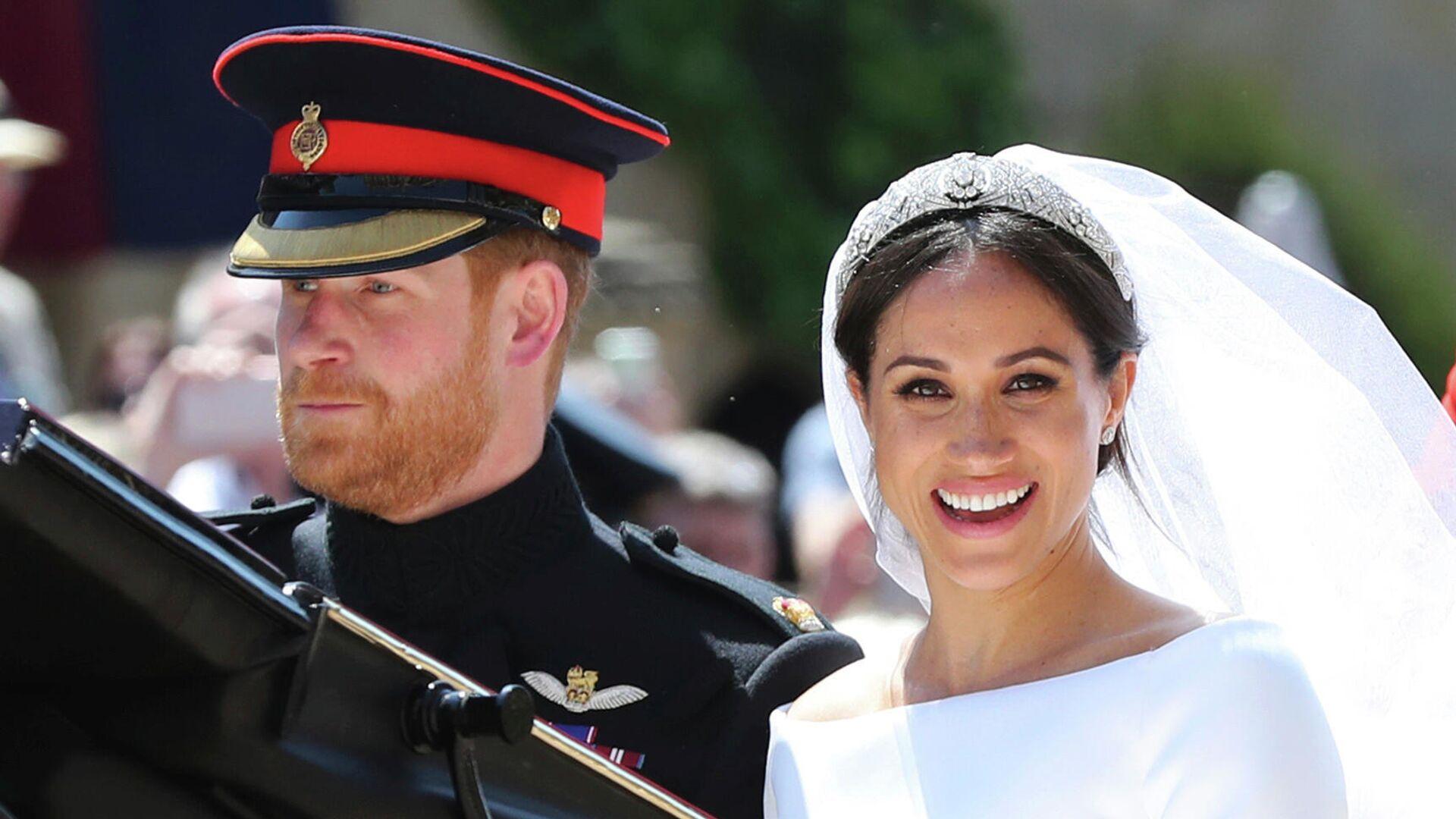 Meghan Markle, junto al príncipe Harry el día de su boda - Sputnik Mundo, 1920, 10.08.2021