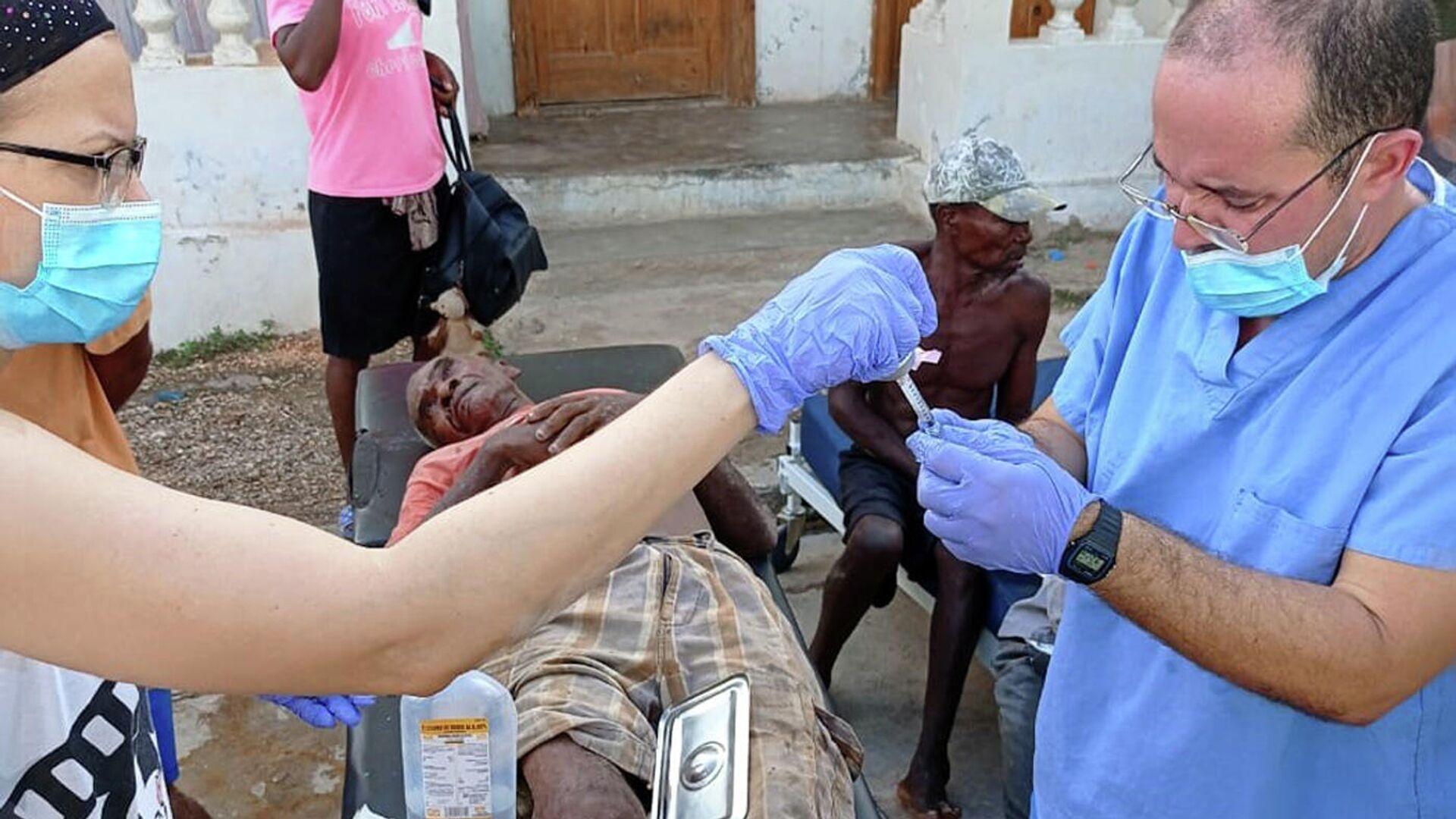 Brigada médica cubana en Haití brinda atención de primeros auxilios a damnificados por terremoto - Sputnik Mundo, 1920, 22.08.2021