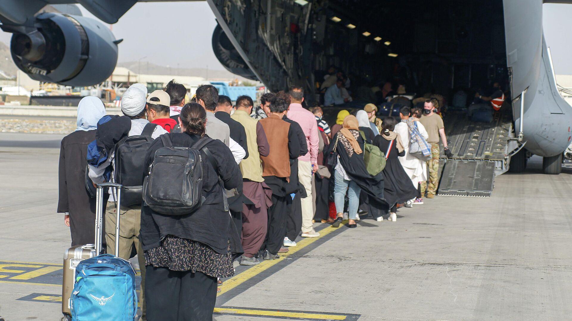 Evacuación en el aeropuerto de Kabul - Sputnik Mundo, 1920, 20.08.2021