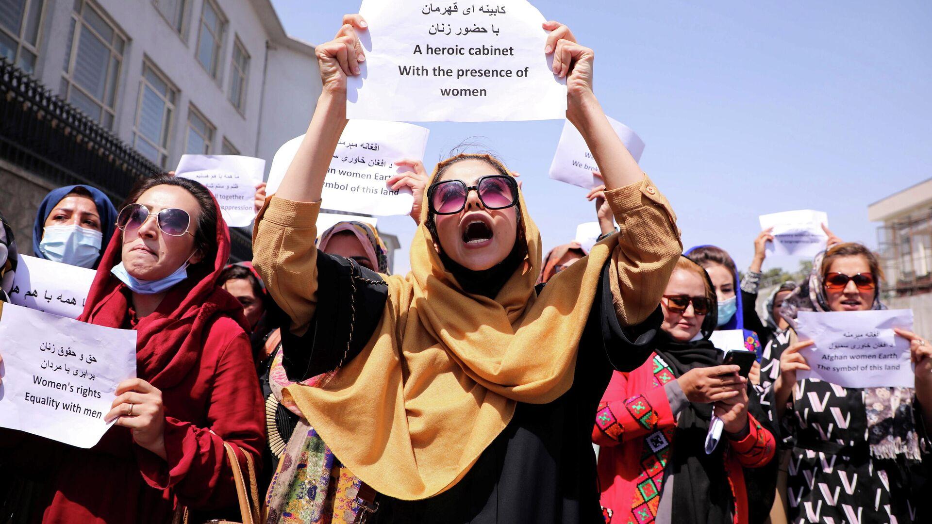 Una manifestación por los derechos de las mujeres en Kabul - Sputnik Mundo, 1920, 03.09.2021