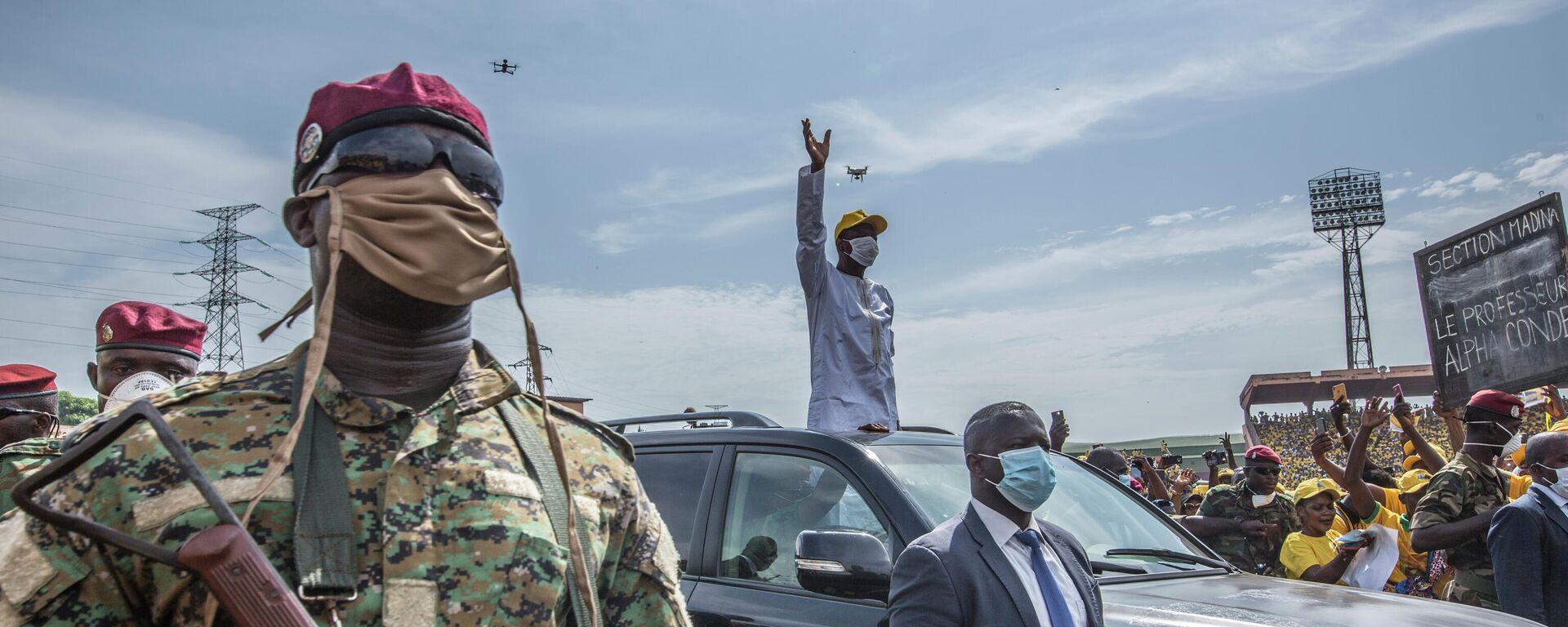 Alpha Conde, presidente de Guinea, durante un acto de campaña electoral en Conakry, el 18 de octubre del 2020 - Sputnik Mundo, 1920, 05.09.2021