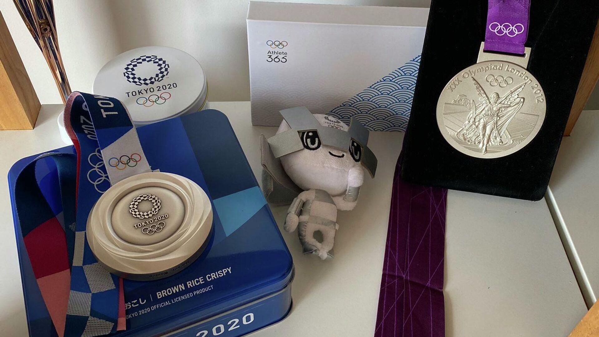 Una medalla de plata de los JJOO Tokyo 2020 - Sputnik Mundo, 1920, 09.09.2021