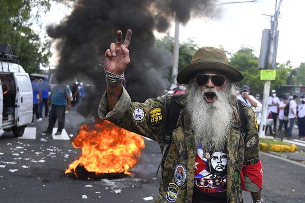 Una protesta en San Salvador contra la polémica Ley Bitcóin que convierte a la cripto en una moneda de curso legal. - Sputnik Mundo