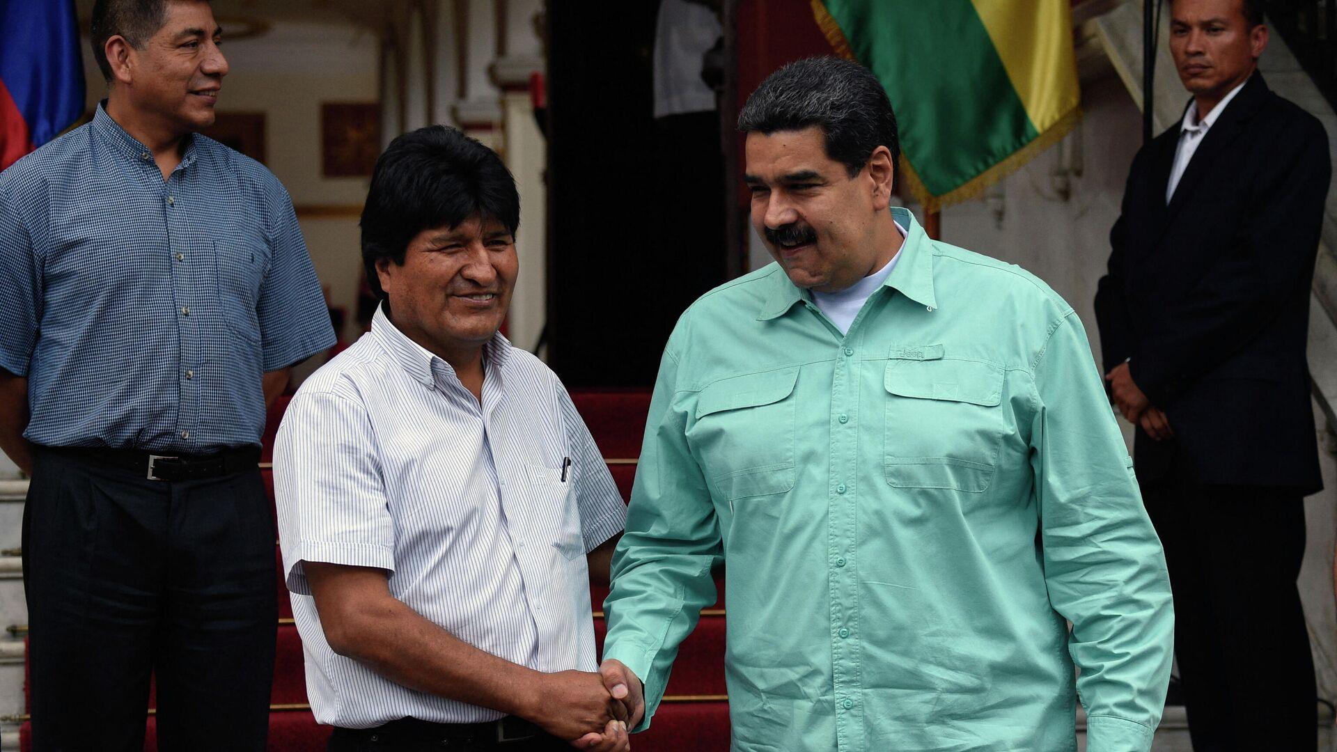 El presidente de Venezuela, Nicolás Maduro, junto al exmandatario de Bolivia, Evo Morales - Sputnik Mundo, 1920, 11.09.2021