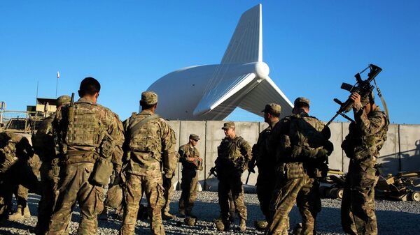 U.S. soldiers from the 3rd Cavalry Regiment prepare for a mission at Forward Operating Base Gamberi which remains part of the ongoing Operation Resolute Support in the Laghman province of Afghanistan December 11, 2014. - Sputnik Mundo