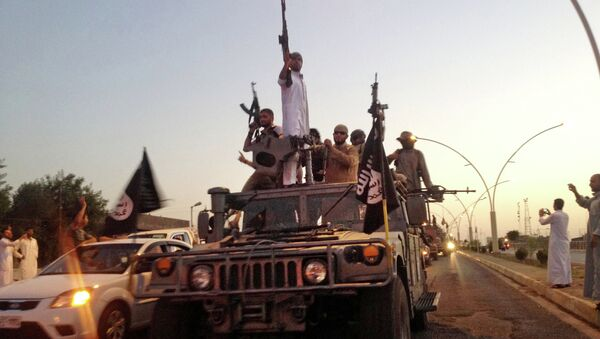 Combatientes del grupo yihadista Estado Islámico (EI) - Sputnik Mundo
