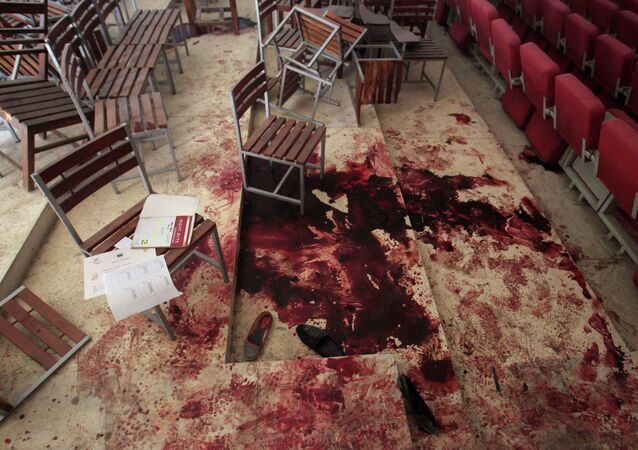 Shoes lie in blood on the auditorium floor at the Army Public School, which was attacked by Taliban gunmen, in Peshawar, December 17, 2014