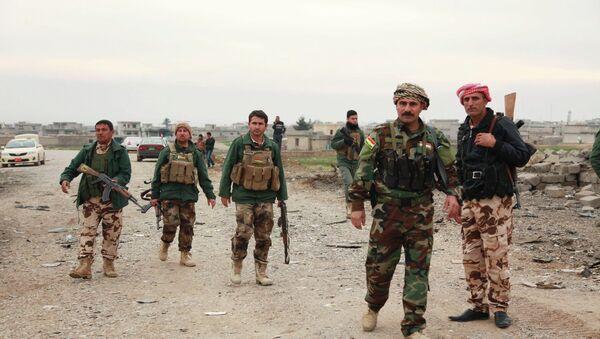 Miembros de tropas del Kurdistán iraquí - Sputnik Mundo