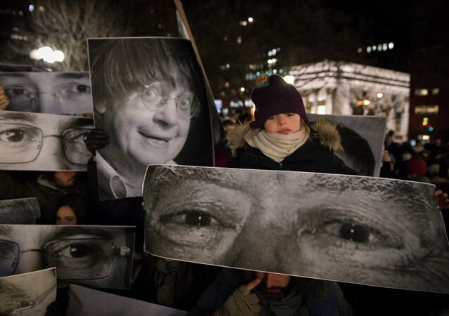 Mourners hold signs depicting the eyes of victims during a rally in support of Charlie Hebdo, a French satirical weekly newspaper that fell victim to an terrorist attack, Wednesday, Jan. 7, 2015