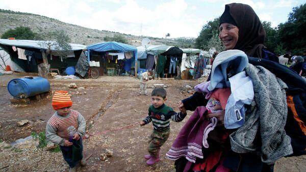 Oposición siria llama a comunidad internacional a ayudar a refugiados que sufren por frío - Sputnik Mundo