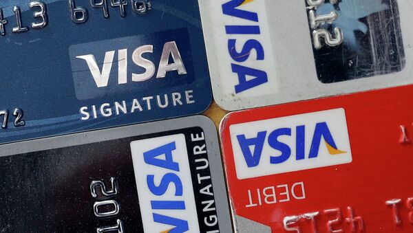 In this April 25, 2013 file photo, credit and debit cards are displayed for a photographer in Baltimore. Visa Inc. reports quarterly earnings on Thursday, April 24, 2014 - Sputnik Mundo