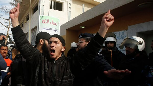 A Palestinian Salafist shouts during a protest against satirical French weekly magazine Charlie Hebdo's cartoons of the Prophet Mohammad, outside the French Cultural Centre in Gaza city January 19, 2015. - Sputnik Mundo
