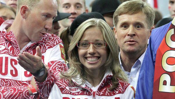 Serguéi Kirdyapkin, Olga Kaniskina y su entrenador Victor Cheguin - Sputnik Mundo