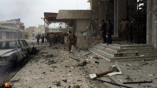 Kurdish peshmerga fighters secure a hotel near police headquarters in oil-rich Kirkuk, 290 kilometers (180 miles) north of Baghdad, Iraq, Friday, Jan. 30, 2015 - Sputnik Mundo
