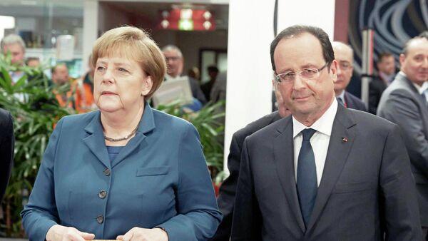 Francois Hollande und Angela Merkel - Sputnik Mundo