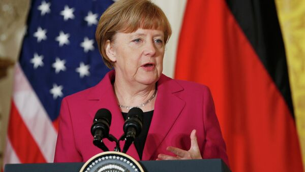 German Chancellor Angela Merkel speaks as she holds a joint news conference with U.S. President Barack Obama in the East Room of the White House in Washington February 9, 2015 - Sputnik Mundo