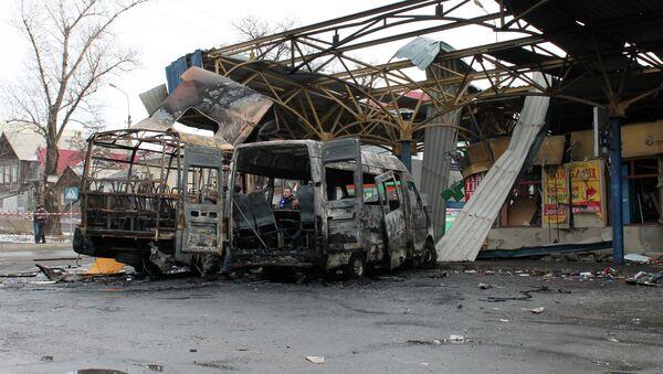 Последствия обстрела автостанции в Донецке - Sputnik Mundo