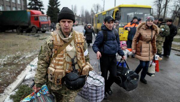 Refugiados ucranianos - Sputnik Mundo
