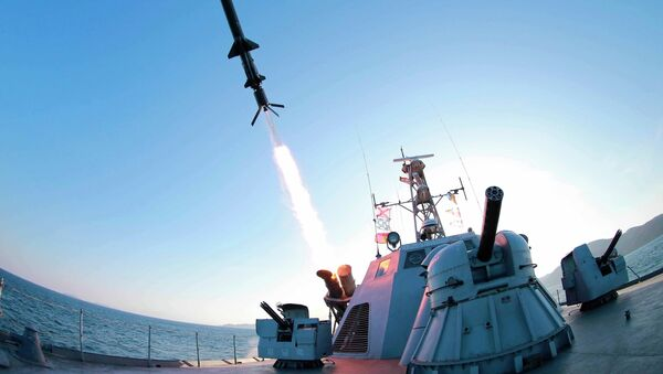 A missile is fired from a naval vessel during the test-firing of a new type of anti-ship cruise missile to be equipped at Korean People's Army (KPA) naval units in this undated photo released by North Korea's Korean Central News Agency (KCNA) in Pyongyang February 7, 2015. - Sputnik Mundo