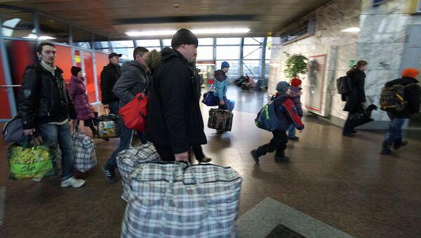 Más de 900.000 refugiados de Donbás se encuentran en Rusia - Sputnik Mundo
