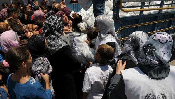 Distribución de ropa para refugiados de Siria - Sputnik Mundo