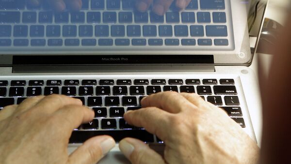 This photo illustration shows hands typing on a computer keyboard on Wednesday Feb. 27,2013 - Sputnik Mundo