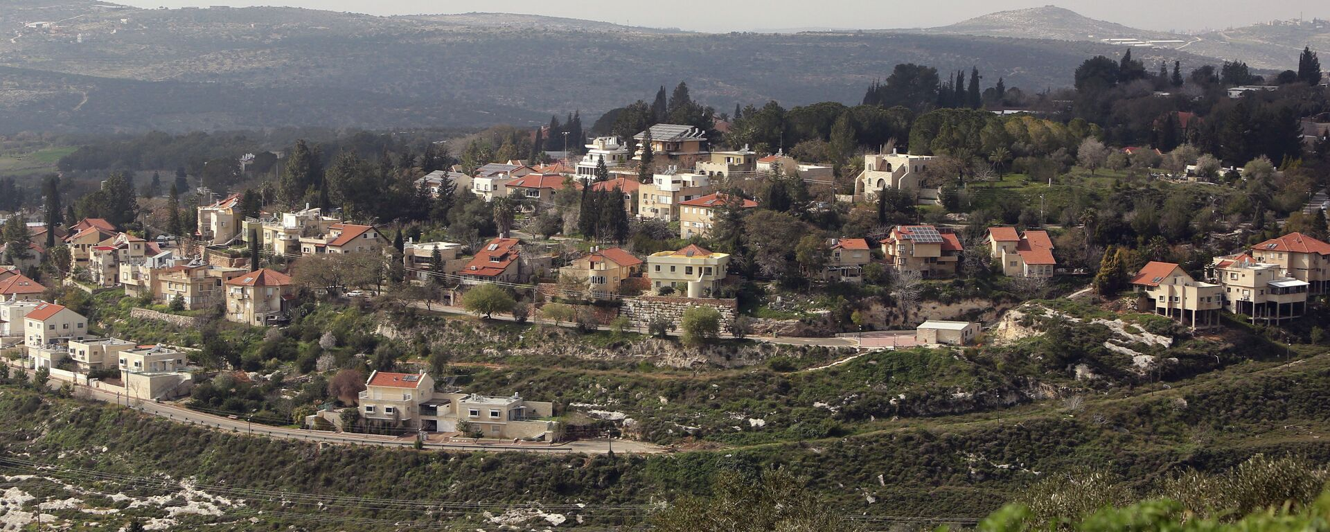 A picture shows a partial view of the Israeli settlement of Qadumim (Kedumim), near the Palestinian town of Nablus, in the Israeli-occupied West Bank, on February 9, 2015 - Sputnik Mundo, 1920, 11.04.2019