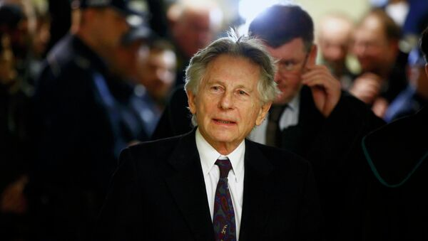 Filmmaker Roman Polanski walks on a corridor during a break of a court hearing in Krakow February 25, 2015 - Sputnik Mundo