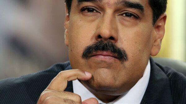 Venezuela's President Nicolas Maduro pauses during his speech at a press conference at Miraflores Presidential Palace in Caracas, Venezuela, Tuesday, Dec. 30, 2014 - Sputnik Mundo
