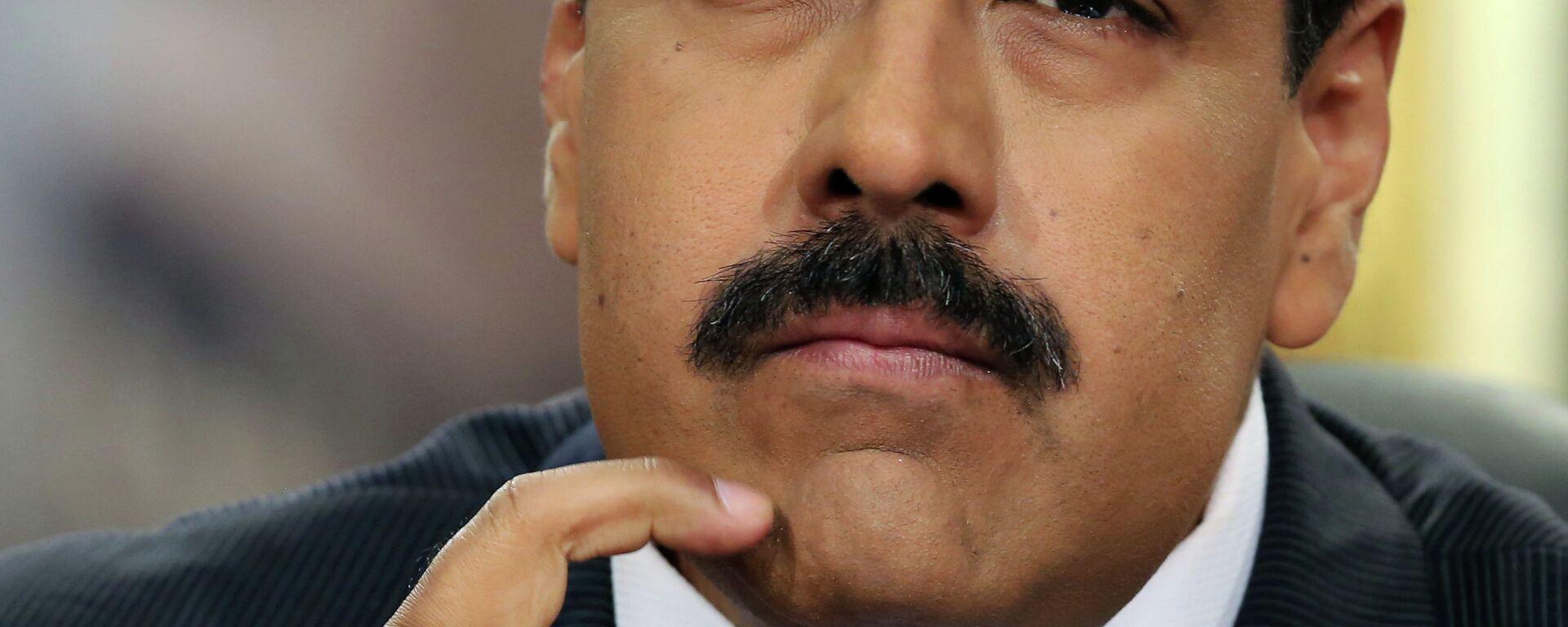 Venezuela's President Nicolas Maduro pauses during his speech at a press conference at Miraflores Presidential Palace in Caracas, Venezuela, Tuesday, Dec. 30, 2014 - Sputnik Mundo, 1920, 12.05.2021